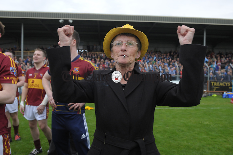 Miltown fan Helen O Brien cheers on her side following the win over Cooraclare in the county senior football final at Cusack park. Photograph by John Kelly.