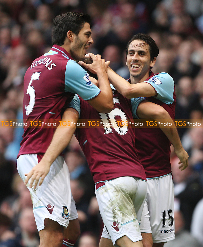 Mark Noble celebrates with Yossi Benayoun and James Tomkins after scoring the 3rd goal for West Ham from the penalty spot - West Ham United vs Southampton, Barclays Premier League at Upton Park, West Ham - 20/10/12 - MANDATORY CREDIT: Rob Newell/TGSPHOTO - Self billing applies where appropriate - 0845 094 6026 - contact@tgsphoto.co.uk - NO UNPAID USE.