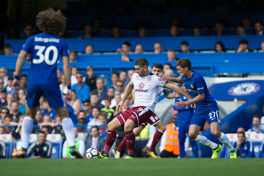 Burnley's Sam Vokes holds off the challenge from Chelsea's Andreas Christensen<br /> <br /> Photographer Craig Mercer/CameraSport<br /> <br /> The Premier League - Chelsea v Burnley - Saturday August 12th 2017 - Stamford Bridge - London<br /> <br /> World Copyright &copy; 2017 CameraSport. All rights reserved. 43 Linden Ave. Countesthorpe. Leicester. England. LE8 5PG - Tel: +44 (0) 116 277 4147 - admin@camerasport.com - www.camerasport.com