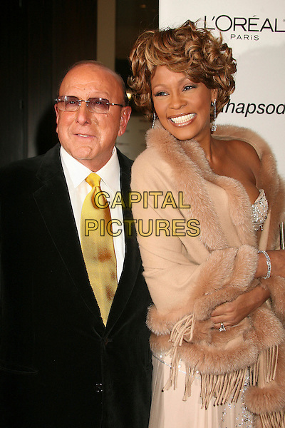 CLIVE DAVIS & WHITNEY HOUSTON.Clive Davis 2007 Pre-Grammy Awards Party at the Beverly Hilton Hotel, Beverly Hills, USA..February 10th, 2007.half length black suit beige cream wrap shawl dress glasses.CAP/ADM/BP.©Byron Purvis/AdMedia/Capital Pictures