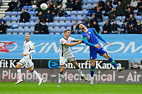 Ben Wilmot of Swansea City vies for possession with Kieffer Moore of Wigan Athletic during the Sky Bet Championship match between Wigan Athletic and Swansea City at The DW Stadium in Wigan, England, UK. Saturday 2 November 2019
