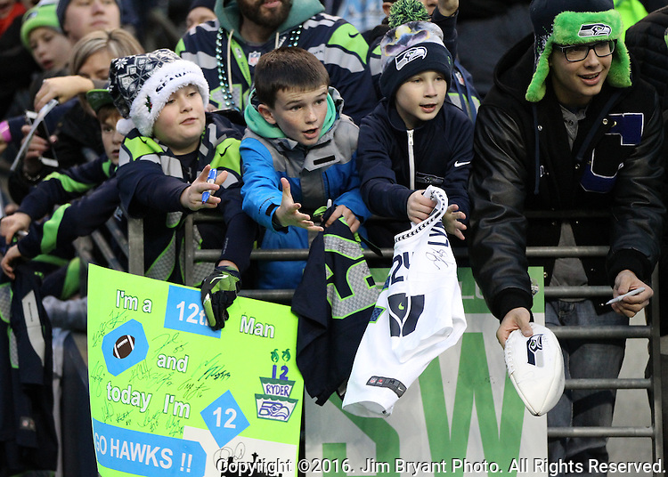 Seattle Seahawk fans wait for players to sign autographs before their game against the Carolina Panthers at CenturyLink Field in Seattle, Washington on December 4, 2016.  Seahawks beat the Panthers 40-7.  ©2016. Jim Bryant photo. All Rights Reserved.
