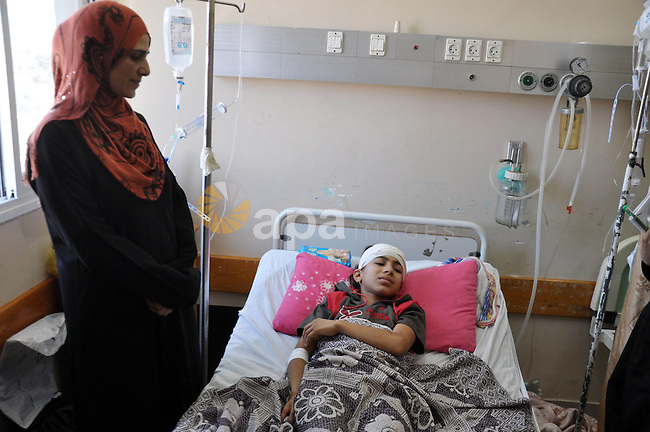 Palestinian Children rests at the Shifa hospital to receiving treatment on the first day of the Muslim festival of Eid al-Fitr in Gaza City on July 28, 2014.  on the beginning of the Muslim Eid festival ending the month-long fast of Ramadan. Israeli tank fire killed a four-year-old boy in the northern Gaza Strip, the first death since the two sides began observing an unofficial lull, Palestinian medics said.. Photo by Mohammed Talatene