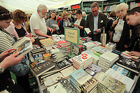 Pictured: People read books in the festival book store Monday 30 May 2016<br />
