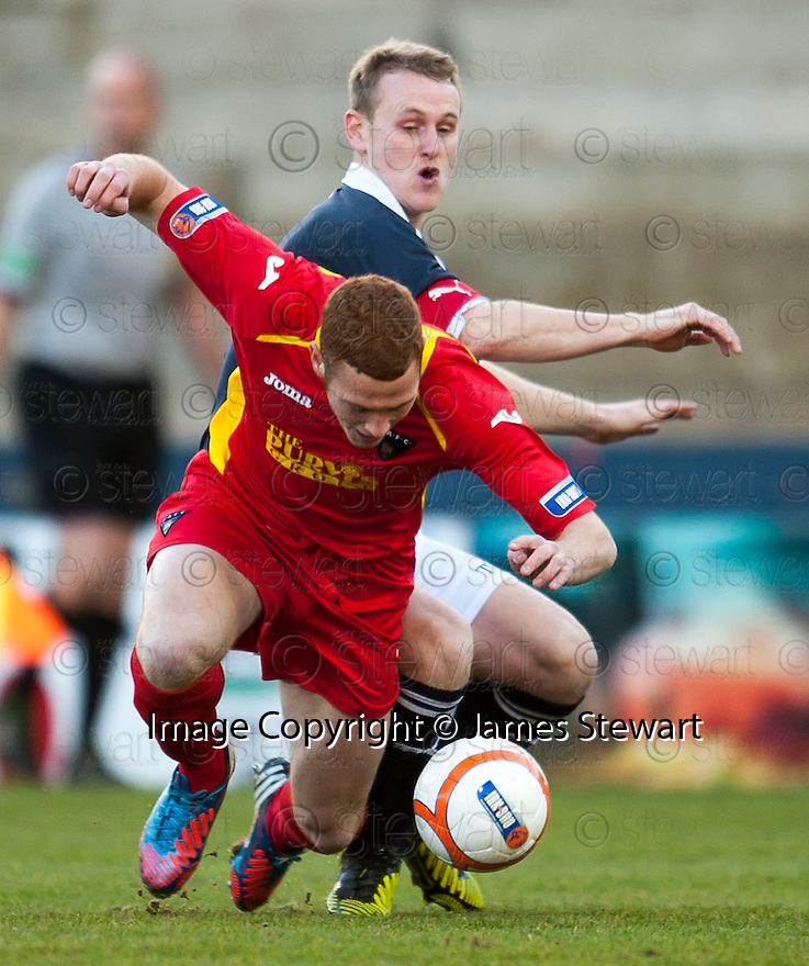 Pars' Ryan Thomson  is brought down by Raith's Allan Walker ...