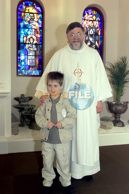 Fr. Fintan Brennan-Whitmore and Robert Burns after First Communion in St Marys Drumcar..Picture Fran Caffrey Newsfile