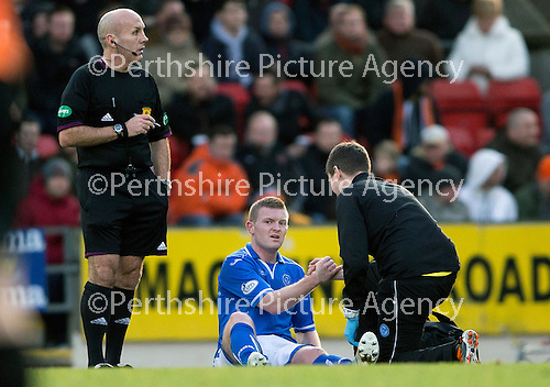 St Johnstone v Dundee United.....29.12.13   SPFL<br /> Brian Easton with an injured hamstring<br /> Picture by Graeme Hart.<br /> Copyright Perthshire Picture Agency<br /> Tel: 01738 623350  Mobile: 07990 594431