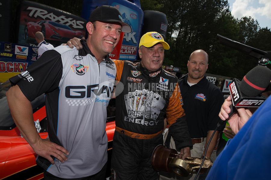 May 11, 2013; Commerce, GA, USA: NHRA funny car driver Johnny Gray (right) celebrates with son Shane Gray after winning the Southern Nationals at Atlanta Dragway. Mandatory Credit: Mark J. Rebilas-