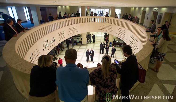 Lobbyist Clark Smith, right, with the Southern Strategy Group and Patrick Bell talk on the 4th floor rotunda during Florida House of Representatives floor debate at the Florida Capitol in Tallahassee, Florida.