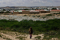 a woman walks towards her village In Somaliland's Capital Hargeysa on fiday October the 19th 2007.///..Though not internationally recognized, Somaliland has a working political system, government institutions, a police force and its own currency. The territory has worked hard to win support for its claims to be a sovereign state. The former British protectorate has also escaped much of the chaos and violence that plague the rest of Somalia, although frequent clashes at the boarder with Puntland have created many problems recently. Poverty and unemployment are widely spread. the economy is highly dependent on money sent home by the diaspora..