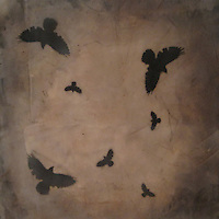 Mixed media encaustic photo painting of crows in sepia sky at dusk.