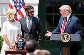 United States President Donald J. Trump, right, makes remarks as he hosts Martin Truex Jr., the NASCAR Cup Series champion, center, and his team, on the South Lawn of the White House in Washington, DC on Monday, May 21, 2018.  Truex competes full-time in the Monster Energy NASCAR Cup Series for Furniture Row Racing.  Pictured at left is  Sherry Pollex, the longtime girlfriend of Truex Jr. who has been battling ovarian cancer since 2014.<br /> Credit: Ron Sachs / CNP