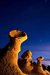 Hoodoos glow at dusk in Goblin Valley State Park, Utah.