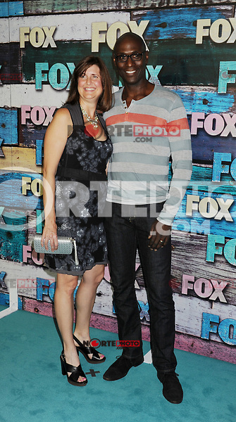 WEST HOLLYWOOD, CA - JULY 23: Lance Reddick and wife Stephanie Reddick arrive at the FOX All-Star Party on July 23, 2012 in West Hollywood, California. / NortePhoto.com<br /> <br /> **CREDITO*OBLIGATORIO** *No*Venta*A*Terceros*<br /> *No*Sale*So*third* ***No*Se*Permite*Hacer Archivo***No*Sale*So*third*&Acirc;&copy;Imagenes*con derechos*de*autor&Acirc;&copy;todos*reservados*. /eyeprime