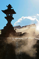 Stone lantern at Yubatake - Kusatsu is one of the largest natural hot springs in Japan with abundant supplies of naturally hot spring water gushing from its sources.   Kusatsu's is a well known spa for recovering from surgery and illnesses.