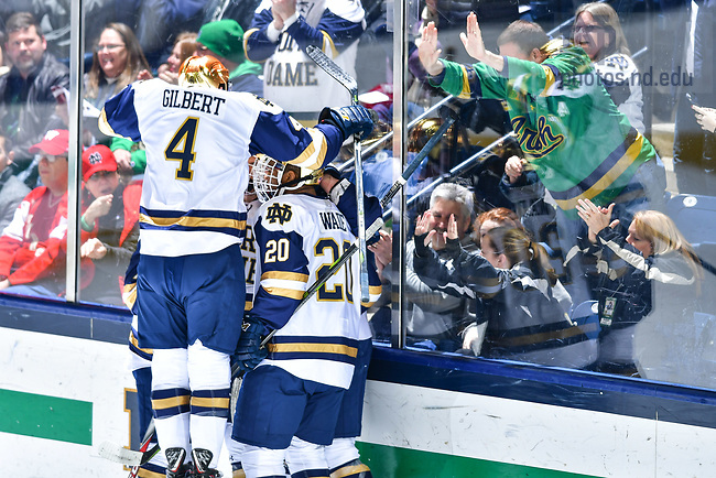 January 19, 2018; Hockey players celebrate after a goal. (Photo by Matt Cashore/University of Notre Dame)