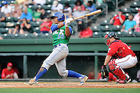 Designated hitter Alfredo Escalera (26) of the Lexington Legends bats in a game against the Greenville Drive on Sunday, April 27, 2014, at Fluor Field at the West End in Greenville, South Carolina. The Greenville catcher is Jake Romanski. Greenville won, 21-6. (Tom Priddy/Four Seam Images)