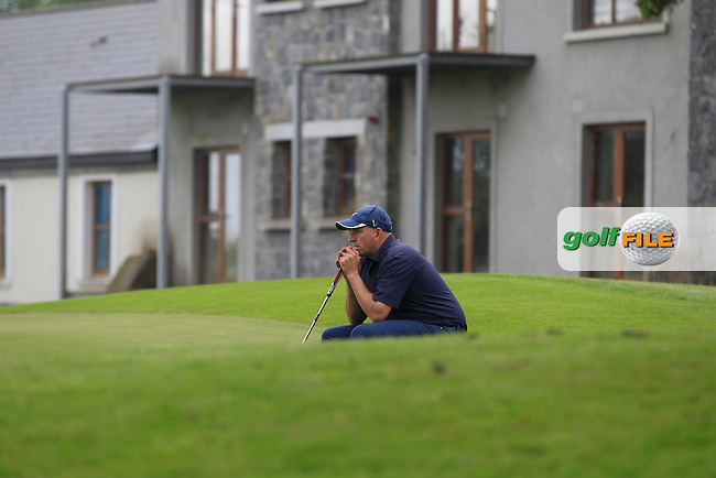 Tony Cleary (Woodstock) on the 18th green during Round 1 of the Irish Mid-Amateur Open Championship at New Forest on Saturday 20th June 2015.<br /> Picture:  Thos Caffrey / www.golffile.ie
