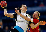 BELGRADE, SERBIA - DECEMBER 15:  Victoria Zhilinskayte of Russia (L)  is challenged by Laerke Moller (R) of Denmark during the Women's European Handball Championship 2012 fifth place match between Denmark and Russia at Arena Hall on December 15, 2012 in Belgrade, Serbia. (Photo by Srdjan Stevanovic/Getty Images)