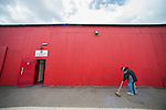Ebbsfleet 0 Dover Athletic 1, 23/08/2014. Stonebridge Road, Skrill South play-off final. Dover won the match 1-0 to secure promotion to the Conference Premier. Man sweeps up outside the players' entrance Photo by Simon Gill