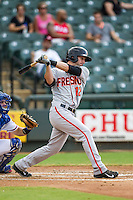 Fresno Grizzlies shortstop Nick Noonan (12) follows through on his swing during the Pacific Coast League baseball game against the Round Rock Express on June 22, 2014 at the Dell Diamond in Round Rock, Texas. The Express defeated the Grizzlies 2-1. (Andrew Woolley/Four Seam Images)