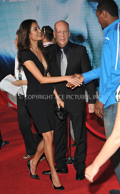 WWW.ACEPIXS.COM . . . . . ....September 24 2009, New York City....Bruce Willis and his wife Emma Heming arriving at the world premiere of 'Surrogates' at the El Capitan Theater on September 24, 2009 in Hollywood, Los Angeles....Please byline: JOE WEST - ACEPIXS.COM....Ace Pictures, Inc:  ..(212) 243-8787 or (646) 679 0430..e-mail: picturedesk@acepixs.com..web: http://www.acepixs.com