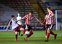 Lincoln City U18's Elliott Sartorius vies for possession with South Shields U18's Bailey Judson<br /> <br /> Photographer Andrew Vaughan/CameraSport<br /> <br /> The FA Youth Cup Second Round - Lincoln City U18 v South Shields U18 - Tuesday 13th November 2018 - Sincil Bank - Lincoln<br />  <br /> World Copyright © 2018 CameraSport. All rights reserved. 43 Linden Ave. Countesthorpe. Leicester. England. LE8 5PG - Tel: +44 (0) 116 277 4147 - admin@camerasport.com - www.camerasport.com
