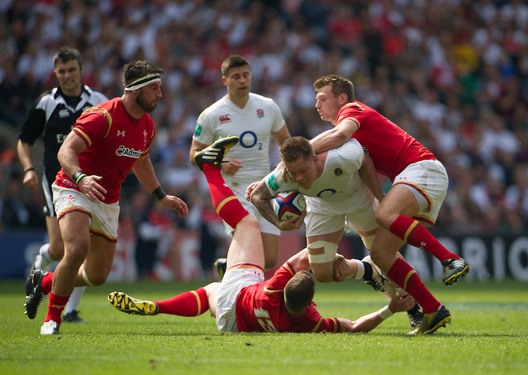 Teimana Harrison of England is tackled by Dan Biggar of Wales<br /> <br /> Photographer Ashley Western/CameraSport<br /> <br /> International Rugby Union Friendly  - Old Mutual Wealth Cup - England v Wales - Sunday 29th May 2016 - Twickenham, London<br /> <br /> World Copyright &copy; 2016 CameraSport. All rights reserved. 43 Linden Ave. Countesthorpe. Leicester. England. LE8 5PG - Tel: +44 (0) 116 277 4147 - admin@camerasport.com - www.camerasport.com