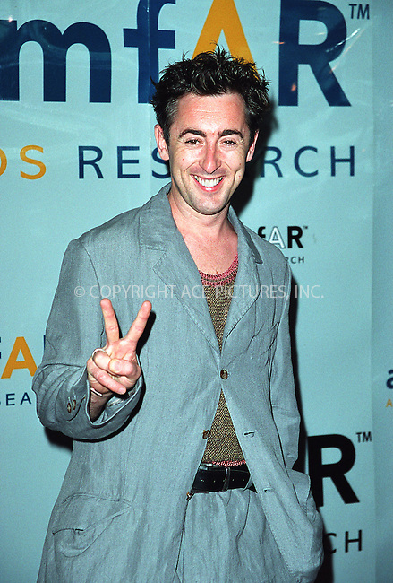 "Actor Alan Cumming at AmFar's ""Honoring With Pride"" event at Chelsea Piers in New York. June 26, 2002. Please byline: Alecsey Boldeskul/NY Photo Press.   ..*PAY-PER-USE*      ....NY Photo Press:  ..phone (646) 267-6913;   ..e-mail: info@nyphotopress.com"