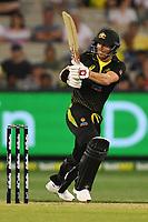1st November 2019; Melbourne Cricket Ground, Melbourne, Victoria, Australia; International T20 Cricket, Australia versus Sri Lanka; David Warner of Australia hits the ball through the leg side - Editorial Use