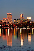 Minneapolis skyline at sunset reflected in Lake Calhoun. Lake Calhoun is the biggest lake in Minneapolis, Minnesota, and part of the city's Chain of Lakes. Surrounded by city park land and circled by bike and walking trails, it is popular for many outdoor activities. The lake has an area of 401 acres (1.62 km2) and a maximum depth of 87 feet (27 m). The Twin Cities are the sixteenth-largest metropolitan area in the United States.