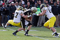 Michigan Wolverine linebacker Jack Ryan sacks Purdue Boilermaker quarterback Caleb TerBush as lineman Craig Roh (88) closes in. The Michigan Wolverines defeated the Purdue Boilermakers 44-13 on October 6, 2012 at Ross-Ade Stadium in West Lafayette, Indiana.