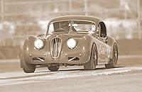 A vintage Jaguar sports car competes in a vintage race at Daytona INternational Speedway, Daytona Beach, FL, in 2000.  (Photo by Brian Cleary/www.bcpix.com)