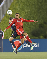 New England Revolution defender Chris Tierney (8) and Toronto FC forward Luis Silva (11) battle for head ball.  In a Major League Soccer (MLS) match, the New England Revolution (blue) defeated Toronto FC (red), 2-0, at Gillette Stadium on May 25, 2013.