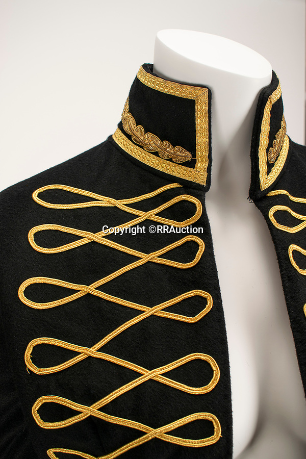 BNPS.co.uk (01202 558833)<br /> Pic: RRAuction/BNPS<br /> <br /> Pictured: Black Dante Military Matador Coat - Wool and cashmere military matador-style asymmetrical tailcoat with extensive gold braid work detailing. Estimate: $150,000  <br /> <br /> A vast archive of items relating to British fashion designer Alexander McQueen have emerged for sale for over £1m.<br /> <br /> The enormous collection has been amassed by one of his personal friends -Ruti Danan who worked worked for the late icon for two years between 1994 and 1996.<br /> <br /> During that period she amassed a treasure trove of items including items of clothing, behind-the-scene photographs and sketches of new designs.<br /> <br /> She has kept the collection for over two decades but has now decided the time is right to part with it for the first time.<br /> <br /> There are an incredible 74 lots set to go under the hammer at RR Auction of Boston, Massachusetts.