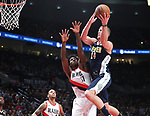 Portland Trail Blazers forward Ed Davis (17) defends Denver Nuggets center Mason Plumlee (24) in the second half at Moda Center.<br /> Photo by Jaime Valdez