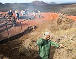 Tourists watch smoke from crater fire Parque Nacional de Timanfaya, national park, Lanzarote, Canary Islands,