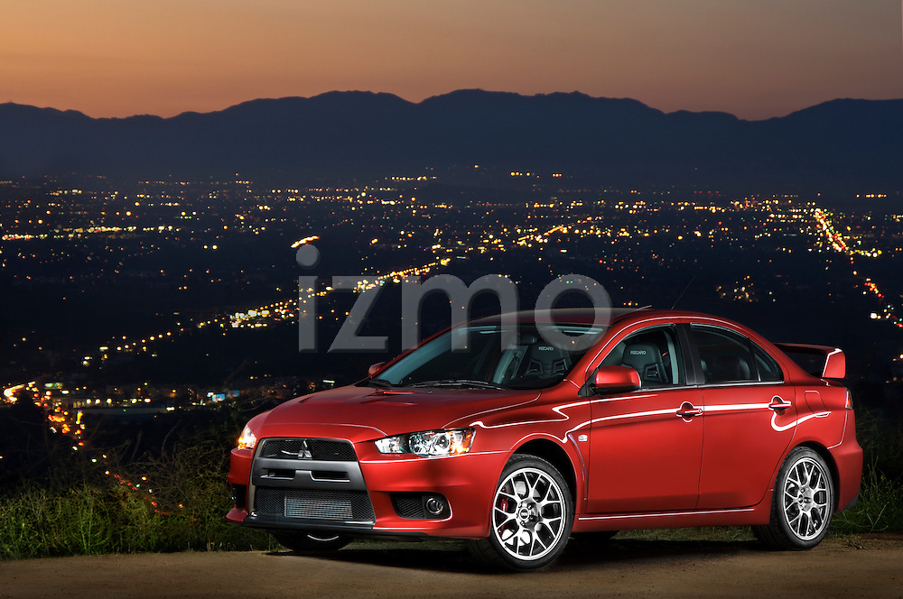 Front three quater hero photo of a 2009 Mitsubishi Lancer Evolution MR on Mulholland Drive at night in Los Angeles, California.Front three quarter view of a .