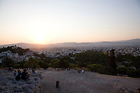 People gather to watch the sunset at Acropolis Hill in Athens, Greece on July 2, 2013.