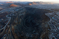 The open-pit mine operated by Volcan is seen in the center of the city of Cerro de Pasco, Peru, photographed from a hot air balloon.