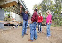 NWA Democrat-Gazette/DAVID GOTTSCHALK  Shawn Shrum (left), assistant road superintendent with Washington County, leads a tour Monday, September 28, 2015 underneath the Harvey Dowell Bridge on Harvey Dowell Road in Washington County. Members of the Quorum Court and County Officials toured the Household Hazardous Waste Facility, the bridge and other road  construction sites in the county.