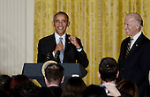 United States President Barack Obama (L) jokes while explaining what the First Lady Michelle Obama would do if he would stay four more years as President during a reception for Hispanic Heritage Month in the East Room of the White House on October 12, 2016 in Washington, DC. <br /> Credit: Olivier Douliery / Pool via CNP