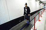 Stockholm 2014-03-21 Ishockey Kvalserien AIK - R&ouml;gle BK :  <br /> AIK:s Akim Aliu g&aring;r p&aring; kryckor p&aring; v&auml;g till omkl&auml;dningsrummet efter matchen<br /> (Foto: Kenta J&ouml;nsson) Nyckelord:  portr&auml;tt portrait depp besviken besvikelse sorg ledsen deppig nedst&auml;md uppgiven sad disappointment disappointed dejected skada skadan ont sm&auml;rta injury pain