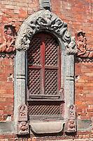 Nepal, Patan.  Decorative Stone Carvings around House Window.