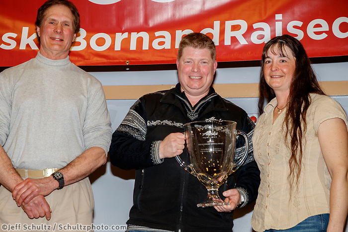 The Alaska Airlines Leonhard Seppala Humanitarian Award is presented by Scott Habberstad, director of sales&nbsp;and community marketing for Alaska Airlines and ITC chief veterinarian Stu Nelson to Jessie Royer at the Nome Musher's Award Banquet during the 2017 Iditarod on Sunday March 19, 2017.<br /> <br /> Photo by Jeff Schultz/SchultzPhoto.com  (C) 2017  ALL RIGHTS RESERVED
