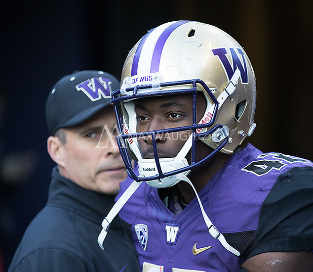 Corey Littleton takes the field for the last time in Husky Stadium.