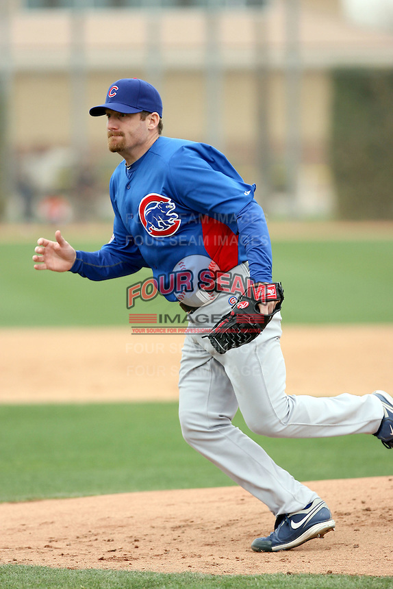 Ryan Dempster #46 of the Chicago Cubs participates in pitchers fielding practice during spring training workouts at the Cubs complex on February 19, 2011  in Mesa, Arizona. .Photo by Bill Mitchell / Four Seam Images.