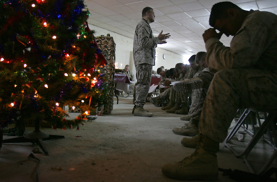 The Marines of 2nd Battalion 5th Marines celebrate midnight services at their base - Hurricane Point - in Ramadi, Iraq on Christmas Eve December 24, 2004.