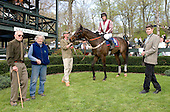 David Semmes and Dot Smithwick, left, join Swimming River in the winner's circle after the Alfred Hunt.
