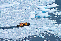 A zodiac manuevers through the brash ice at Neko Harbor, Antarctica.